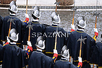 Pontifical Swiss Guard.The Corps of the Pontifical Swiss Guard or Swiss Guard,Guardia Svizzera Pontificia,responsible for the safety of the Pope, including the security of the Apostolic Palace. It serves as the de facto military of Vatican City.Pope Benedict XVI at the end of the message 'Urbi et Orbi from the central balcony of the Basilica of St. Peter in the Vatican today, April 4, 2010.