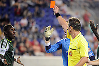 Referee Alex Prus gives a red card to Kalif Alhassan (11) (L) of the Portland Timbers. The New York Red Bulls defeated the Portland Timbers 2-0 during a Major League Soccer (MLS) match at Red Bull Arena in Harrison, NJ, on September 24, 2011.