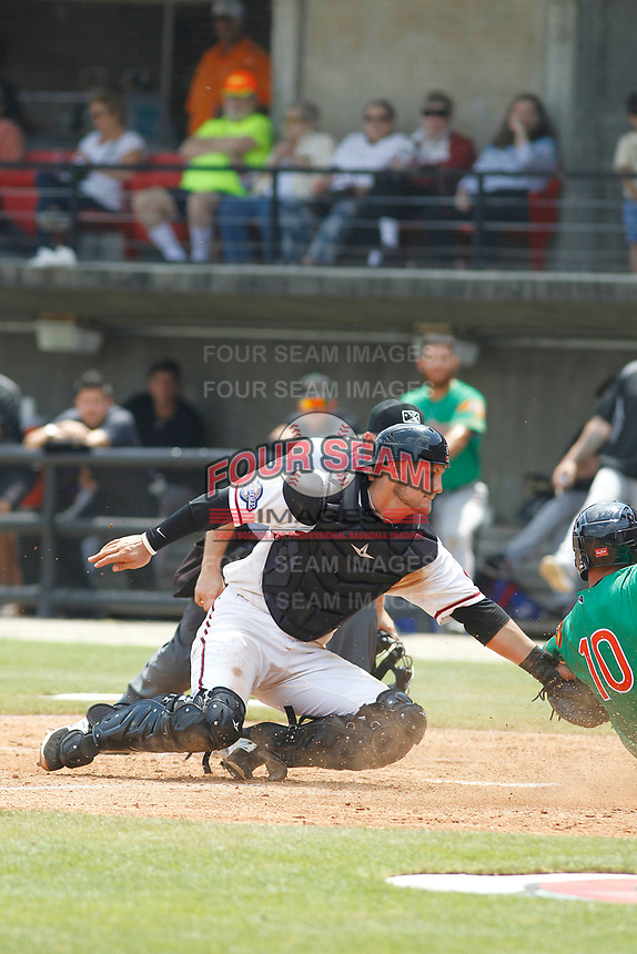 Carolina Mudcats catcher Max McDowell (8) applies the tag at home plate during a game against the Down East Wood Ducks on April 27, 2017 at Five County Stadium in Zebulon, North Carolina. Carolina defeated Down East 9-7. (Robert Gurganus/Four Seam Images)