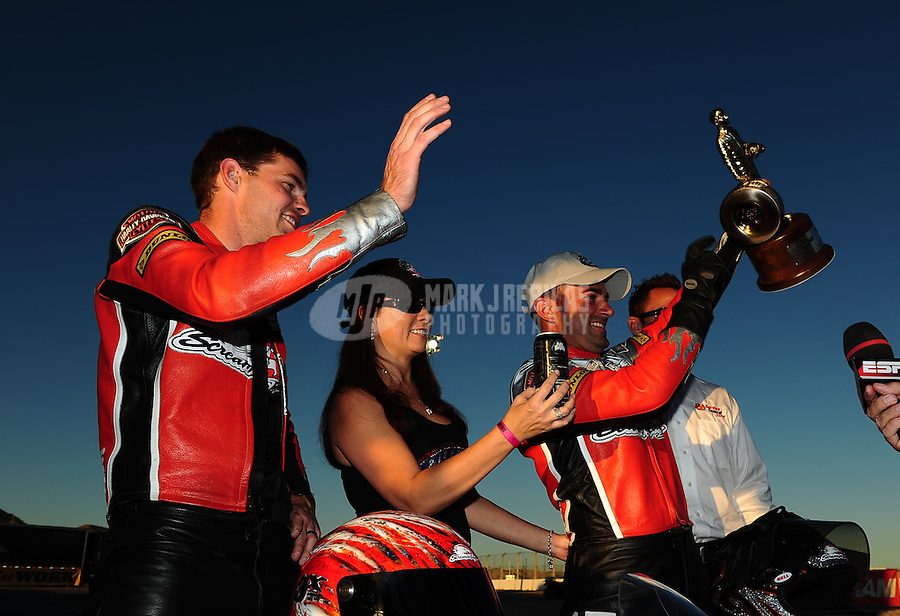 Oct. 30, 2011; Las Vegas, NV, USA: NHRA pro stock motorcycle rider Eddie Krawiec (right) celebrates alongside teammate Andrew Hines after winning the Big O Tires Nationals at The Strip at Las Vegas Motor Speedway. Mandatory Credit: Mark J. Rebilas-
