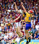 Peter Duggan of Clare in action against Daithi Burke of Galway during their All-Ireland semi-final replay at Semple Stadium,Thurles. Photograph by John Kelly.