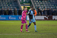 Barry Richardson of Wycombe Wanderers appears to tell Aaron Pierre to thank the fans after a brawl in the tunnel at full time of the Sky Bet League 2 match between Plymouth Argyle and Wycombe Wanderers at Home Park, Plymouth, England on 30 January 2016. Photo by Mark  Hawkins / PRiME Media Images.