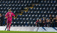 Goalkeeper Ryan Allsop of Wycombe Wanderers throws his gloves to young supporters following his first match for the club during the Sky Bet League 2 match between Wycombe Wanderers and Luton Town at Adams Park, High Wycombe, England on 6 February 2016. Photo by Andy Rowland.