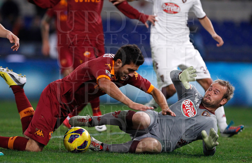 Calcio, Serie A: AS Roma vs Torino. Roma, stadio Olimpico, 19 novembre 2012..AS Roma midfielder Marquinho, of Brazil, falls over Torino goalkeeper Jean Fraocois Gillet, of Belgium, right, during the Italian Serie A football match between AS Roma and Torino at Rome's Olympic stadium, 19 November 2012..UPDATE IMAGES PRESS/Isabella Bonotto