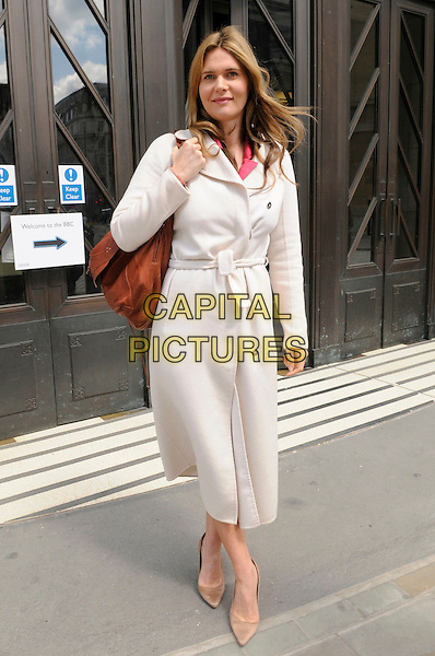 Celia Walden.At BBC building, London, England, UK, 21st May 2011..full length white biege shoes   cream coat belted brown bag pregnant .CAP/IA.©Ian Allis/Capital Pictures.
