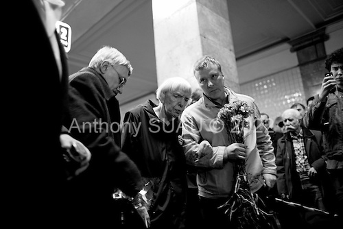 Moscow, Russia<br /> March 31, 2010<br /> <br /> Ludmila Alexeeva, 82 years old putting flowers at the Park Kultura subway station where at least 12 people were killed by a terrorist bomb the day before.<br /> <br /> She is Chair of the Moscow Helsinki Group, is the doyenne of Russia's human rights community. Thirty years ago, she was one of the original Soviet-era dissidents who spoke out against repression. Today, she is not afraid to raise her voice in the renewed fight for rights in Russia, including criticizing policies on hate crimes as well as the war in Chechnya, and is a mentor to the new generation of dissidents. Alexeeva published the seminal book Soviet Dissent in 1985. She also served as President of the International Helsinki Federation for Human Rights - an umbrella group of human rights organizations from 38 countries -- from 1999 to 2004.
