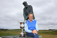 Adrian Morrow (Portmarnock) at the statue of Tom Morris after winning the Ulster Seniors Open Championship at Rosapenna Golf Resort in Downings, Donegal, Ireland.<br /> <br /> Picture: Thos Caffrey / Golffile<br /> <br /> All photo usage must carry mandatory copyright credit (&copy; Golffile | Thos Caffrey)