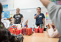 Gianna Zinnen '19 (light hair) and Ellen Prince '20 (dark hair) present.<br /> Occidental students give presentations on STEM (science, technology, engineering, and mathematics) to students at Buchanan Street Elementary School in the Highland Park area of Los Angeles, Calif., March 8, 2018.<br /> In 30-minute presentations to kindergarten to sixth-grade students, Boundless Brilliance's teams of college students, all women currently attending Occidental, go into classrooms to create excitement about science. Through simple experiments (such as building a bridge between two chairs using only newspapers and tape) and a message couched in confidence, respect, and teamwork, their message to everyone—and young girls in particular—is simple: You are brilliant and you can be a scientist if you want to be.<br /> (Photo by Marc Campos, Occidental College Photographer)