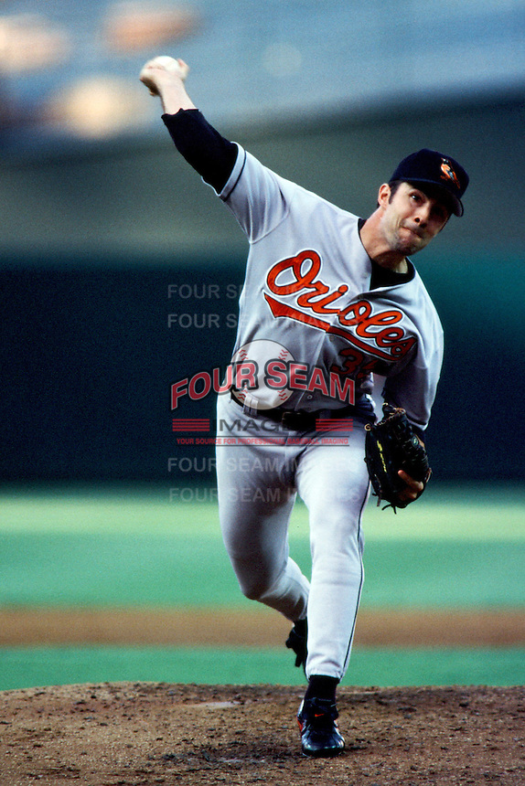 Mike Mussina of the Baltimore Orioles pitches during a 1999 Major League Baseball season game against the Anaheim Angels at Angel Stadium in Anaheim, California. (Larry Goren/Four Seam Images)