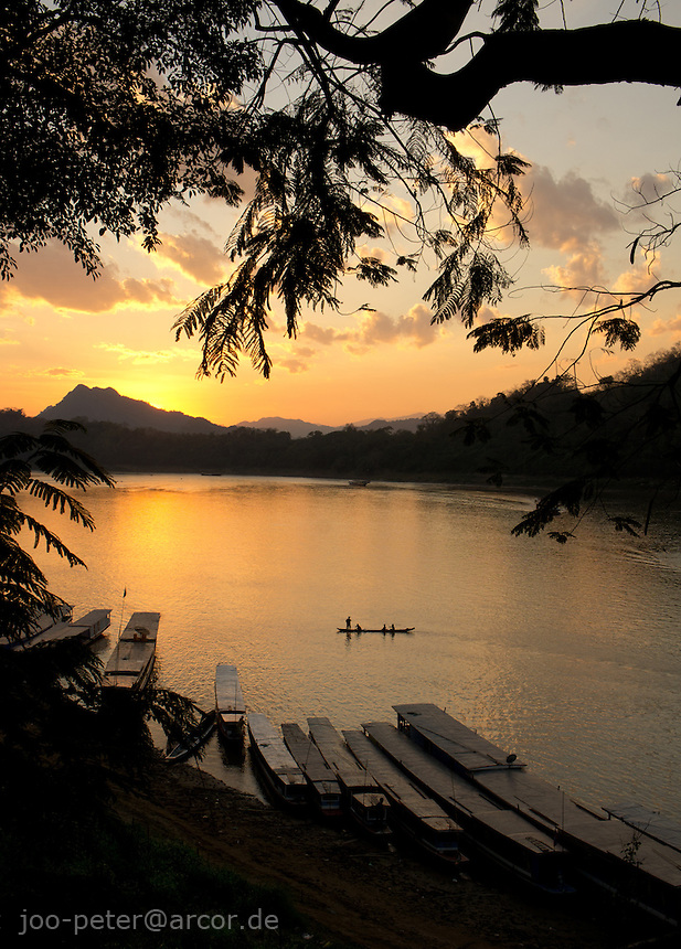 boats on Mekong river at sunset time, , Luang Prabang,  Laos, 2012