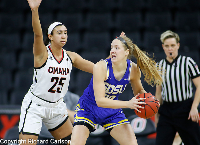 December 29, 2019; Omaha, NE, USA; Tori Nelson #20 of South Dakota State works against Emily Petersen #25 of Omaha in Summit League women's basketball Sunday at Baxter Arena in Omaha, NE. (Photo by Richard Carlson)