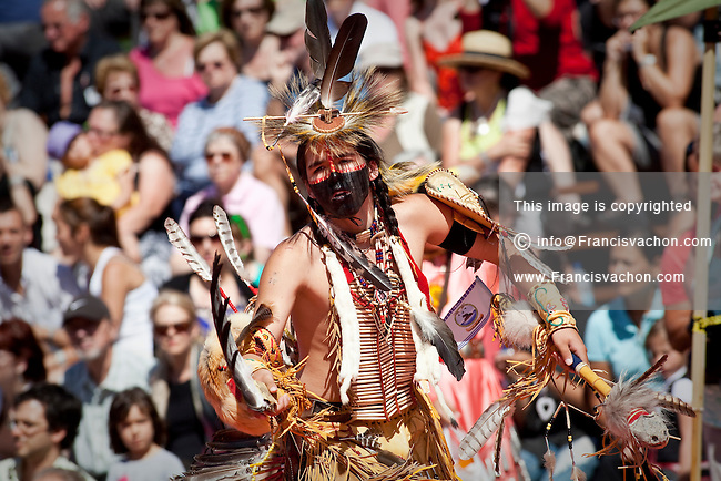 A young natives wearing Huron-Wendat traditional dresses and paint takes part into the dance contest of the Wendake Pow-Wow July 1, 2012. The Wyandot (also called Huron) are indigenous peoples of North America, known in their native language of the Iroquoian family as the Wendat.