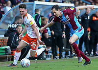 Blackpool's Jordan Thompson gets away from Scunthorpe United's Josh Morris<br /> <br /> Photographer David Shipman/CameraSport<br /> <br /> The EFL Sky Bet League One - Scunthorpe United v Blackpool - Friday 19th April 2019 - Glanford Park - Scunthorpe<br /> <br /> World Copyright © 2019 CameraSport. All rights reserved. 43 Linden Ave. Countesthorpe. Leicester. England. LE8 5PG - Tel: +44 (0) 116 277 4147 - admin@camerasport.com - www.camerasport.com