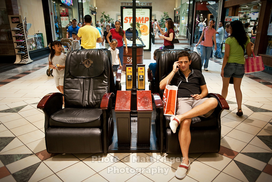 Mateo Codinas (cq), of Mexico City, waits for his girlfriend after a shopping at La Plaza Mall in McAllen, Texas, Saturday, April, 3, 2010. Codinas says he makes the trip up to McAllen twice a year to go shopping....PHOTO/ Matt Nager