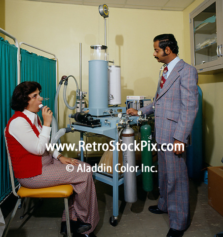 Doctor examining his patients lung capacity