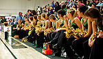 5 December 2009: The UVM Dance Team watch a young fan at a game between the University of Vermont Catamounts and the Manhattan College Jaspers at Patrick Gymnasium in Burlington, Vermont. The Catamounts defeated the visiting Jaspers 78-59 to mark the Lady Cats' second home win of the season. Mandatory Credit: Ed Wolfstein Photo