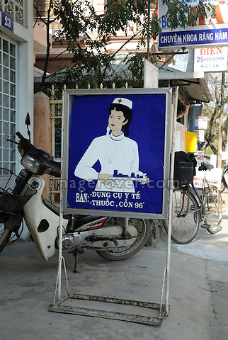 Asia, Vietnam, Hue. Advertisement of a nurse promoting a pharmacy.