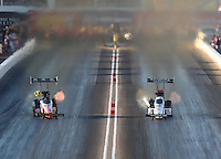 Feb 24, 2017; Chandler, AZ, USA; NHRA top fuel driver Doug Kalitta (left) races alongside Antron Brown during qualifying for the Arizona Nationals at Wild Horse Pass Motorsports Park. Mandatory Credit: Mark J. Rebilas-USA TODAY Sports