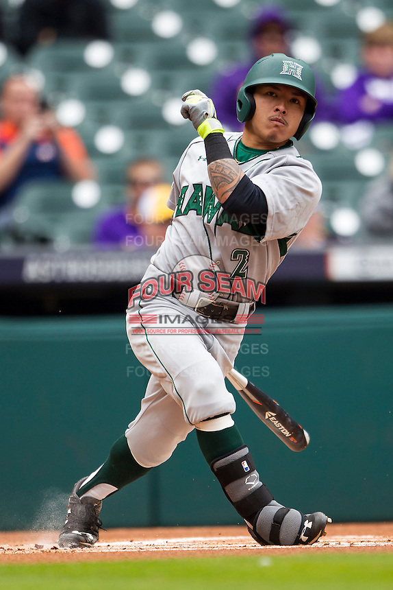 Hawaii Rainbow Warriors outfielder Kaeo Aliviado (2) follows through on his swing during the NCAA baseball game against the Nebraska Cornhuskers on March 7, 2015 at the Houston College Classic held at Minute Maid Park in Houston, Texas. Nebraska defeated Hawaii 4-3. (Andrew Woolley/Four Seam Images)
