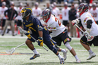 College Park, MD - April 1, 2017: Michigan Wolverines Chase Young (3) runs pass Maryland Terrapins defenders during game between Michigan and Maryland at  Capital One Field at Maryland Stadium in College Park, MD.  (Photo by Elliott Brown/Media Images International)