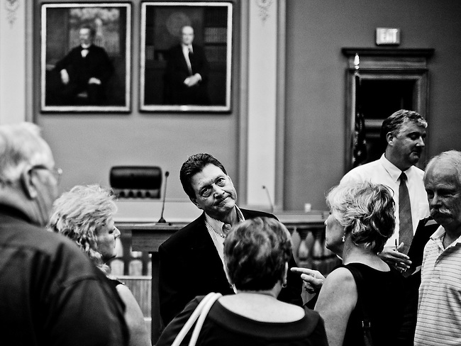 Rep. Lynn Westmoreland, R-Ga., speaks with constituents one on one following his town hall meeting in the old courthouse in Newnan, Ga., on Tuesday, Aug. 13, 2013.