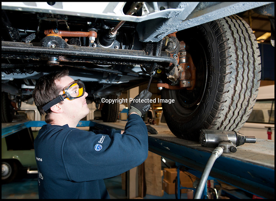 BNPS.co.uk (01202 558833)<br /> Pic: LauraJones/BNPS<br /> <br /> Mechanic Matt Waller doing some pre test checks. <br /> <br /> The last ever delivery of brand new Volkswagen campervans has arrived in Britain marking the end of an era for the iconic 'hippy bus'.<br /> <br /> Ninety nine of the final batch of vans rolled off the production line and onto a container ship bound for British shores after manufacture ceased for good in Brazil in December.<br /> <br /> And though the consignment has only just arrived, almost all of the vans have already been snapped up by eager buyers happy to fork out the £35,000 starting price.<br /> <br /> They are the last brand new campers in all of Europe.