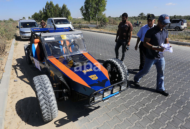 A Palestinian driver with his local made car takes part in a local car race in Gaza city on June 12, 2015. The race organized by Gaza racing club participant by 16 racer from the besieged coastal enclave. Photo by Mohammed Asad