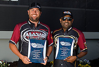 Sep 13, 2013; Charlotte, NC, USA; NHRA top fuel dragster driver Shawn Langdon (left) with teammate Khalid Albalooshi during qualifying for the Carolina Nationals at zMax Dragway. Mandatory Credit: Mark J. Rebilas-
