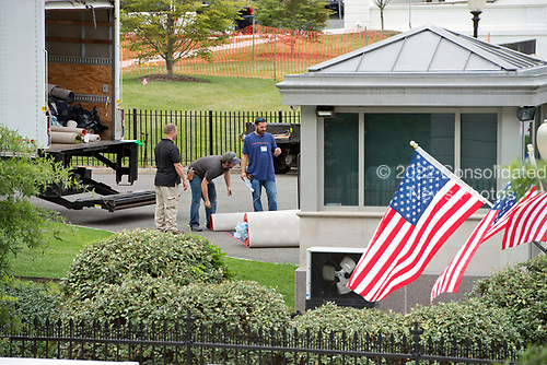 Workers prepare rolls of carpet to carry into the White House West Wing in Washington, DC as it is undergoing renovations while United States President Donald J. Trump is vacationing in Bedminster, New Jersey on Friday, August 11, 2017.<br /> Credit: Ron Sachs / CNP