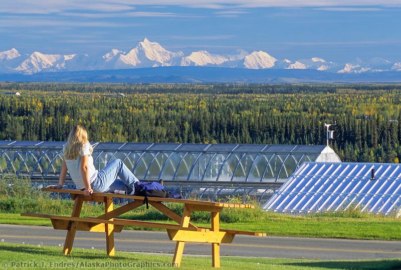 UAF student looks over the Alaska mountain range for the West Ridge at the University of Alaska, Fairbanks, Alaska