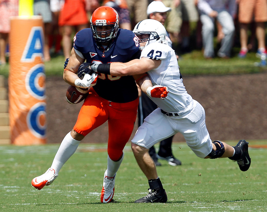 Penn State linebacker Michael Mauti (42) causes Virginia tight end Paul Freedman (88) to fumble the ball during the first half of an NCAA football game Saturday Sept. 8, 2012 in Charlottesville, VA. Photo/Andrew Shurtleff