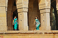 Colorfully dressed Indian women, tomb of Mohammed Shah, Lodhi Gardens, New Delhi, India
