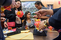 Cynthia Tim, 20, (center from right), Socheata Mam, 19, and Sunwoo Kang, 22, create paper lantern crafts at a Lunar New Year celebration at Middlesex Community College's Asian American Connections Center on Thurs., Feb. 15, 2018. Tim is a Cambodian-American and a second year student at Middlesex Community College studying Business. Mam is a Cambodian-American first year student studying Criminal Justice. Kang is a foreign student from South Korea. The Asian American Connections Center was established at the school using a federal grant in 2016 and serves as a focal point for the Asian community at the school, predominantly Cambodian, to gather, socialize, study, and otherwise take part in student life.