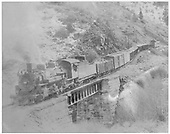 D&amp;RGW #480 with a short eastbound freight crossing Bridge 223-A over Poncha Creek.<br /> D&amp;RGW  near Mears Junction, CO  Taken by Richardson, Robert W. - 11/1950