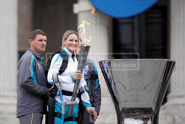 24/08/2012. LONDON, UK. Claire Lomas smiles as she prepares to light the Paralympic Cauldron in Trafalgar Square today (24/08/12). Ms Lomas, formerly a horse event rider, was paralysed from the chest down after being injured during the Osberton Horse Trials and, with the aid of her robotic suit, completed the London Marathon in 2012. Photo credit: Matt Cetti-Roberts