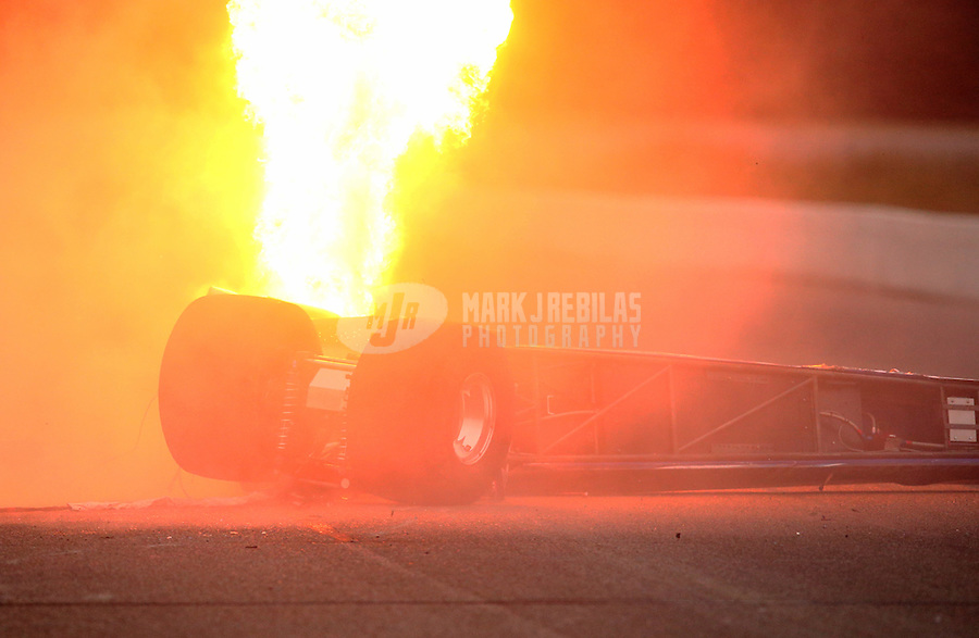 Aug 17, 2014; Brainerd, MN, USA; Fire comes from the car of NHRA top dragster driver Don Kritzky after crashing during the semi finals of the Lucas Oil Nationals at Brainerd International Raceway. Mandatory Credit: Mark J. Rebilas-USA TODAY Sports
