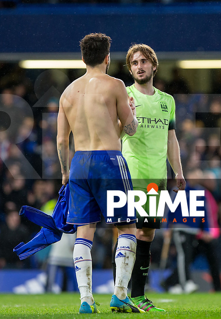 Cesc Fabregas of Chelsea gives his shirt to Aleix García of Man City at the end of the match during the FA Cup 5th round match between Chelsea and Manchester City at Stamford Bridge, London, England on 21 February 2016. Photo by Andy Rowland.
