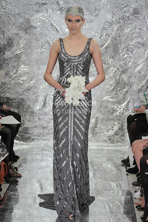 Model Irina Kondratyeva walks runway in Mercury - a hand embroidered powdered silver glazed sequin bridal gown from the Theia Spring 2017 bridal collection by Don O'Neill, during New York Bridal Fashion Week Spring Summer 2017 on April 14, 2016.