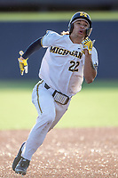 Michigan Wolverines outfielder Jordan Brewer (22) runs to third base against the Rutgers Scarlet Knights on April 26, 2019 in the NCAA baseball game at Ray Fisher Stadium in Ann Arbor, Michigan. Michigan defeated Rutgers 8-3. (Andrew Woolley/Four Seam Images)