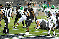 1 September 2011:  FIU running back Darriet Perry (28) scores a touchdown in the first half as the FIU Golden Panthers defeated the University of North Texas, 41-16, at University Park Stadium in Miami, Florida.