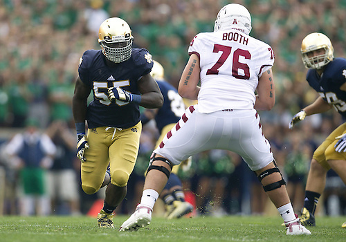 August 31, 2013:  Notre Dame outside linebacker Prince Shembo (55) and Temple offensive lineman Cody Booth (76) during NCAA Football game action between the Notre Dame Fighting Irish and the Temple Owls at Notre Dame Stadium in South Bend, Indiana.  Notre Dame defeated Temple 28-6.