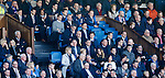 Rangers players watch on intently from the directors box