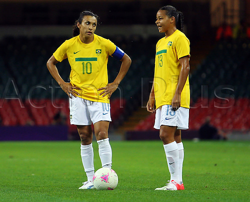 03.08.2012 Cardiff, Wales. Brazil Forward Marta (Tyresö) and Brazil Midfielder Francielle (São José) prepare to take a free kick  during the Olympic Football Women's Quarter Final game between Brazil and Japan.Japan won the game 2-0 and  progress to the Semi-Final of the Olympic Football tournament.