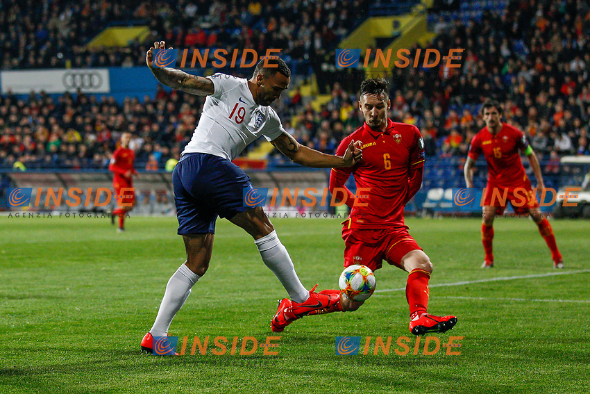 Callum Wilson of England and Zarko Tomasevic of Montenegro  <br /> Podgorica 25-3-2019 <br /> Football Euro2020 Qualification Montenegro - England <br /> Foto Daniel Chesterton / PHC / Insidefoto <br /> ITALY ONLY