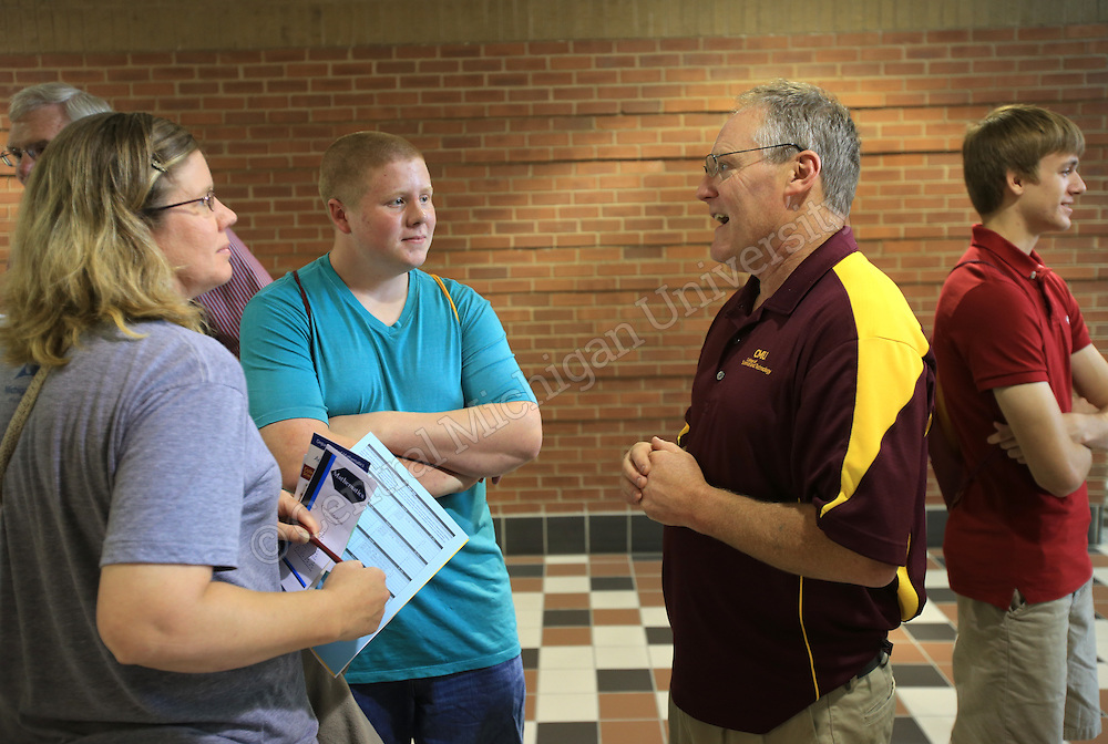 math instuctor talking with parent and student at central michigan university