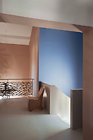 The iron balustrade on the top floor landing is designed with a coral motif by Guy Roisse and executed by Jean Bernard