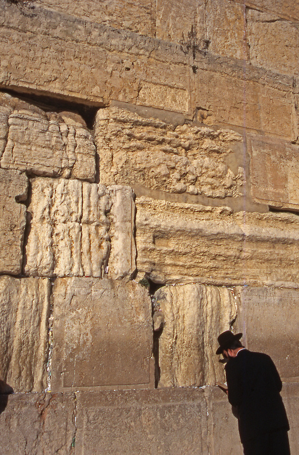 Jerusalem, Temple Mount, Wailing Wall, an orthodox Jewish man reads at ancient temple wall.