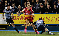 Dragons' Tyler Morgan evades the tackle of Cardiff Blues' Rhun Williams<br /> <br /> Photographer Simon King/CameraSport<br /> <br /> Guinness Pro14 Round 6 - Cardiff Blues v Dragons - Friday 6th October 2017 - Cardiff Arms Park - Cardiff<br /> <br /> World Copyright &copy; 2017 CameraSport. All rights reserved. 43 Linden Ave. Countesthorpe. Leicester. England. LE8 5PG - Tel: +44 (0) 116 277 4147 - admin@camerasport.com - www.camerasport.co