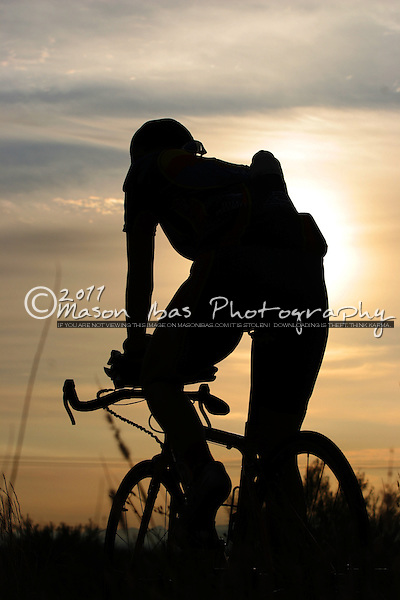A lone cyclist warms up at dawn prior to the Picacho Peak Time Trial north of Tucson.