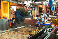 Mixed into hundreds of retail stalls selling meats and produce in Carmel market, Tel Aviv's largest and most popular open-air market, are several food stalls where you can grab a quick and tasty lunch.